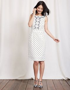 You'd be forgiven for thinking this Sixties wiggle dress walked straight off Carnaby street (and into your wardrobe). It's all about the details, with playful frills, embroidered spots and piping that highlights the defined waist. This versatile fitted style is a sure-fire hit for the 9-to-5 and after hours.