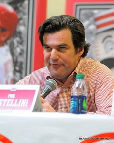 Phil Castellini speaks with fans during the Reds Caravan held at the Lima Mall on Saturday. RICHARD PARRISH / The Lima News