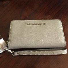 Michael Kors Jet Set Travel Large Coin Wristlet Michael Kors Jet Set Travel Large Coin Wristlet Wallet Leather Pearl gray. New with tag no trades Michael Kors Bags Clutches & Wristlets