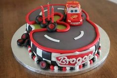 Disney cars cake - Number three track with Lightning Mcqueen racing aroumd it. What 3 year old boy wouldn't love this one? Disney Cars Cake, Disney Cars Birthday, Cars Birthday Parties, Lightning Mcqueen Birthday Cake, Lightning Mcqueen Cake, Lightening Mcqueen, Birthday Cake 30, Birthday Ideas, Third Birthday