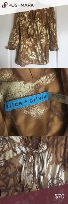 Alice & Olivia Gold Blouse Shine bright in this gorgeous Alice &a Olivia golden blouse! Includes gold buttons and a ladylike tie by the neck. Perfect for work and play! Alice + Olivia Tops Blouses