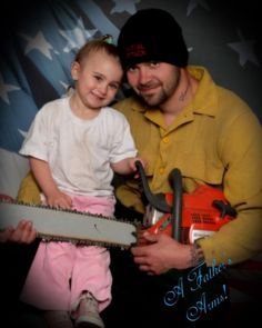 A Father's Arms...why on Earth would someone get a photo made with a chainsaw???