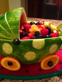 Winner of the 2016 watermelon carving competition - -You can find Watermelon carving and more on our website.Winner of the 2016 watermelon carving competition - - Baby Shower Fruit, Baby Shower Watermelon, Watermelon Fruit, Watermelon Carving, Fruit And Vegetable Carving, Veggie Tray, Watermelon Baby Carriage, Fruit Baby Carriage, Deco Fruit
