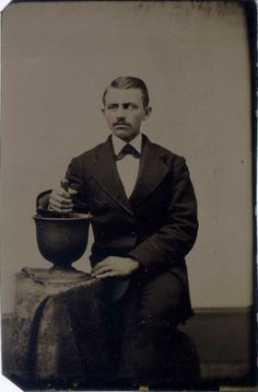 ca. 1870-90's, [tintype portrait of a pharmacist with his large mortar and pestle] via Jeffery Kraus Antique Photographics, Occupational Tintypes