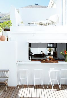 i'd love a window from the kitchen that acts as a bar/eating area when outside (~where the windows roll into the walls)