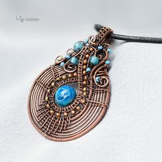 One of a kind copper wire pendant with blue Jasper and seed beads via Artual design. Click on the image to see more!