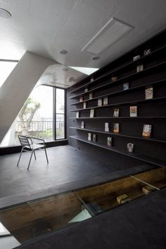 Dark Shelves On Accent Wall Helps Display Items And Books Stand Out