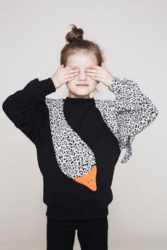 66469dd056c4cb This charming sweatshirt from Danish label Bang Bang Copenhagen features a  unique swan design in monochrome leopard print.