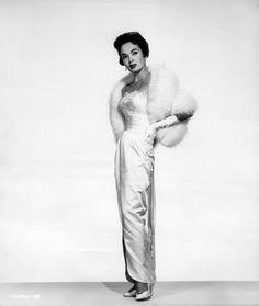 Ann Blyth in white fur cape