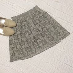 BOGO 1/2 off J Crew Lace Mini Skirt Beautiful lace overlay skirt by J. Crew has a sage green lining that shows through the gray toned lace. Elastic waist. Mini length. Never worn. NWOT. Buy 1 item today, get 1 half off. See first post for details. J. Crew Skirts Mini