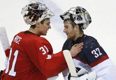 Canada goaltender Carey Price greets USA goaltender Jonathan Quick after the 1-0 Canada win in the men's semifinal ice hockey game at the 2014 Winter Olympics, on February 21, 2014.