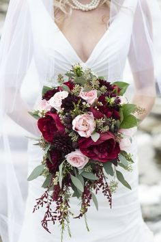 This bouquet is classic and incorporates small pops of pale pink and muted green along with marsala. | via Melanie Bennett Photography