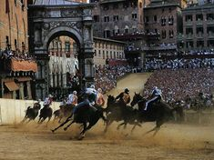 The Palio in Siena is a very special event, one in which every citizen of the city takes part of from the time of their birth. In Siena, you are born into a Contrada and the lifelong journey begins. Cinque Terre, Places To Travel, Places To Visit, Medieval Life, Voyage Europe, Tuscany Italy, Courses, Horse Racing, Italy Travel