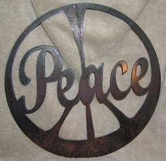 The Peace SignMetal Wall or Garden by frolicnfibers on Etsy, $20.00
