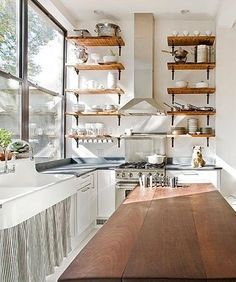 Kitchen: Curtain-covered cabinets!! So cute :) plus love the shelves!