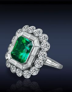 Emerald Cocktail Ring, Featuring: AGL Certified 4.05 Ct Colombian Emerald (Center Stone), Surrounded by Mixed Cut Diamonds Set in Platinum.