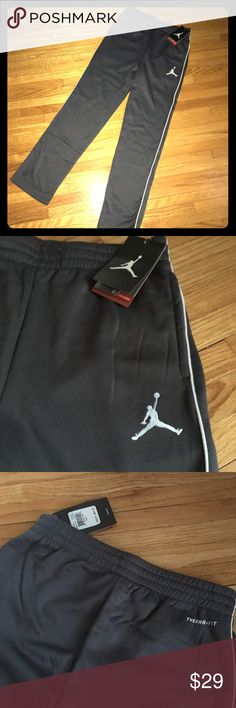 $50 Nike Jordan Track Sweat Pant Joggers Sweats L MSRP $50.00  New With Tags  Nike Jordan Jumpman Therma-Fit Basketball Trackpants  Boys Large 12-13 Years  Waist 14 inches  Top of Waist to Bottom Hem 39 inches  Inseam 29 Inches  Elastic and Drawstring Waist  2 Front Slit Pockets and 1 Backside Pocket  Dark Grey and White Nike Bottoms Sweatpants & Joggers