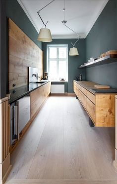 Made out of beautiful oak, with burnished brass details & a little green marble, this modern minimal #kitchen #design is actually part of the…