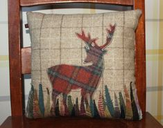 £65.00 Beautiful handmade Highland Stag small cushion, filled with a feather pad. This fine Stag in rust and green tartan is appliquéd on to a background of fawn with chocolate  cream check. Each blade of grass carefully cut out and appliquéd using a mixture of 100% wool tartan and tweed.Only the very best for this fine chap. http://www.onemoregift.co.uk/26_28-cushions/258-beautiful-handmade-highland-stag-small-cushion.html