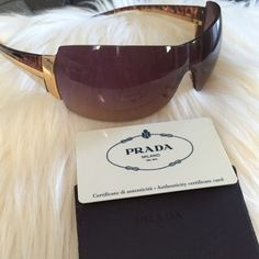 Prada Rimless Shield Sunglasses These have been loved! They are 2007 Prada brown gradient lenses. Some scratches and the nose pads are missing. Comes with authenticity card and I'm currently searching for its case. Prada Accessories Sunglasses