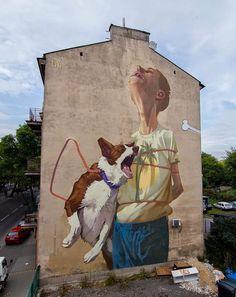 Polish artists Bezt and Sainer aka Etam Cru, recently spent 5 days working on a fresh new mural on the streets of Lubin in Poland, as a part of LFG: ALL MY CITY '14 festival organised by the Europejska Fundacja Kultury Miejskiej and Brain Damage Gallery.