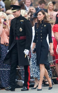 Kate Middleton in a double breasted, navy Alexander McQueen coat dress.
