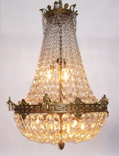 A Fine French 19th/20th Century Empire Style Gilt-Bronze and Diamond-Cut Crystal Basket Style Nine-Light Chandelier with Floral Trim and Acanthus Hooks Holding Rings. Circa: Paris, 1900
