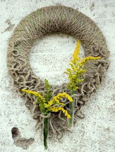 Door wreath with test-tubes for fresh flowers  {very cute, although I would do 3 test tubes}