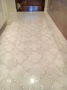 White marble with mother of pearl detail bathroom floor
