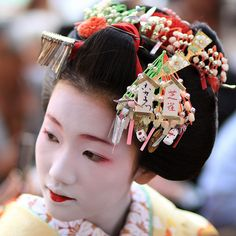 The maiko (apprentice geisha) Fukuho wears a kanzashi (hair ornament) for the month of December.