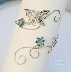Butterfly wire wrapped upper arm cuff by IanirasArtifacts on DeviantArt Cute Jewelry, Body Jewelry, Jewelry Crafts, Jewelry Accessories, Handmade Jewelry, Jewelry Design, Unique Jewelry, Bracelet Bras, Arm Bracelets