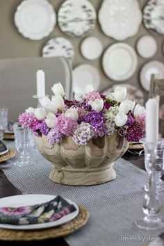 Colorful flowers in a decorative wood bowl for a simple spring centerpiece