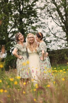 Bridesmaids wear floral dresses   Photography by Helen Russell.