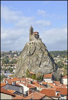 Saint-Michel d'Aiguilhe , near Le Puy-en-Velay, France, built in 962 on a volcanic formation 279 feet high, reached by 268 steps carved into the rock and built to celebrate the return from the pilgrimage of Saint James. In 1429, the mother of Joan of Arc, Isabelle Romée, was said to have visited to the site. Photo by Wilphid on flickr.