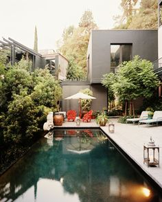 Patio Eclectic Photo - A rectangular pool with an umbrella and chaises