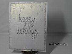 C & J R 2016. Card stock- White, white shimmer & silver glitter. Sentiment is from T. Holtz Happy Holidays thinlits. Background- I used Bo Bunny Sugar Glitter Paste on a Memory Box star stencil. Inside sentiment : A Wish for you : Peace and Happiness at Christmas and throughout the New Year from Yuletide Wishes by Penny Black.