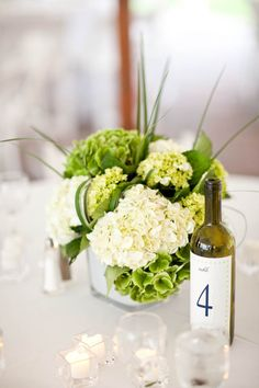 Flowers by flowersbysemia.com, Event Planning   Design by thefifthbridesmaid.com/, Photography by zevfisher.com/ Wine bottle table number?