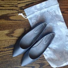 NWOT Dessy satin flats Pewter satin flats never worn. Bought them for a wedding but we decided on a different shoe and I no longer have a receipt. Dust bag included. They came in that and shipping box, no shoe box. Dessy Shoes Flats & Loafers