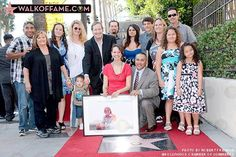 Picture of John Denver's family at the ceremony giving him a star on the Hollywood Walk of Fame on October 24, 2014.  John's daughter Jesse Belle is wearing pink and holding his picture.  His son Zak is kneeling next to Jesse Belle.