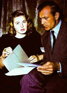 """Ingrid Bergman & Gary Cooper studying the script of """"For Whom The Bell Tolls."""""""