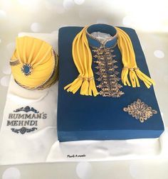 A traditional 17 by 12 inches Sherwani and pagri (Turban) cake for a repeat client! It was much fun making this. Flavours in moist… Indian Cake, Indian Wedding Cakes, Mehndi Cake, Cake Design For Men, Mehedi Design, Cakes For Men, Brownie Cake, Wedding Cake Designs, Fondant Cakes