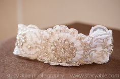 Vintage Glam  Vintage inspired couture wedding garter adorned with encrusted Swarovski crystals and pearl beads. Comes with a delicate and dainty satin toss with crystal embellishments. Please email me with your thigh measurement to ensure the perfect fit!