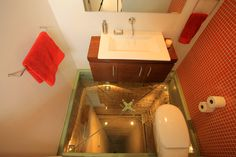 Glass Floored Bathroom Over 15 Story Elevator Shaft photo | not for me...
