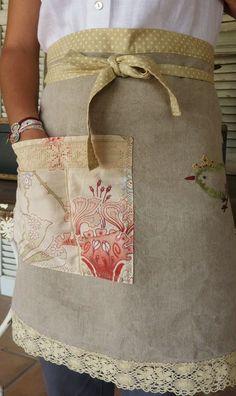 apron--plain fabric background, added pocket/trim, etc. http://www.pinterest.com/source/manon21.blogspot.com/