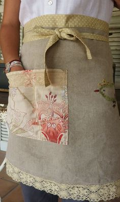 apron--plain fabric background, added pocket/trim, etc. http://www.pinterest.com/source/manon21.blogspot.com/
