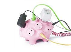 Pork meets plug in this offbeat (and ultimately: bacon-free) power strip design that looks at first glance like a classic child's piggy bank.