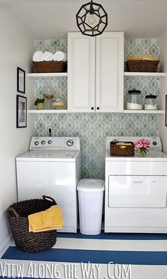 Kelly Marzka is a wife, mom, blogger and creator of a really stylish laundry room. On her website, View Along The Way.com, Kelly takes us on a step-by-step transformation of her functional but dull and boring laundry room to the one you see here. This space is so lovely that the task of doing laundry has to be more fun. And, she and her husband did the refurbishing for only $157!