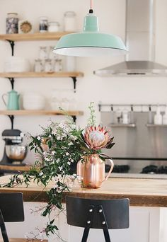 Beautiful kitchen inspo! A mint green pendant light with a copper vase...