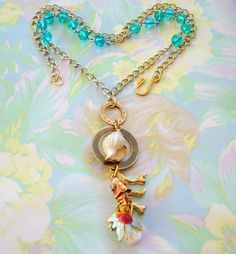 Gifts from the Sea Pendant Necklace FishShellCoral by joyceshafer, $31.50