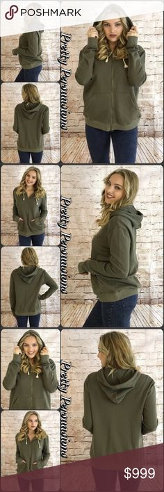 """NWT Olive Cozy Zip Up Hooded Sweatshirt NWT Olive Cozy Zip Up Hooded Sweatshirt   Available in S, L Measurements taken from a small  Length: 27"""" Bust: 42"""" Waist: 44""""  Cotton   Model is wearing a size small  Also available in Navy in a separate listing   Features  • full zip up front • front pockets  • hooded • relaxed, easy fit  • soft, breathable material   Bundle discounts available  No pp or trades  Item # 1/2PP3260350OZH slouchy relaxed fit hoodie olive navy long sleeve layering Pretty…"""